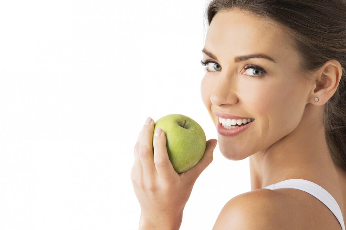 woman with beautiful smiling holding apple